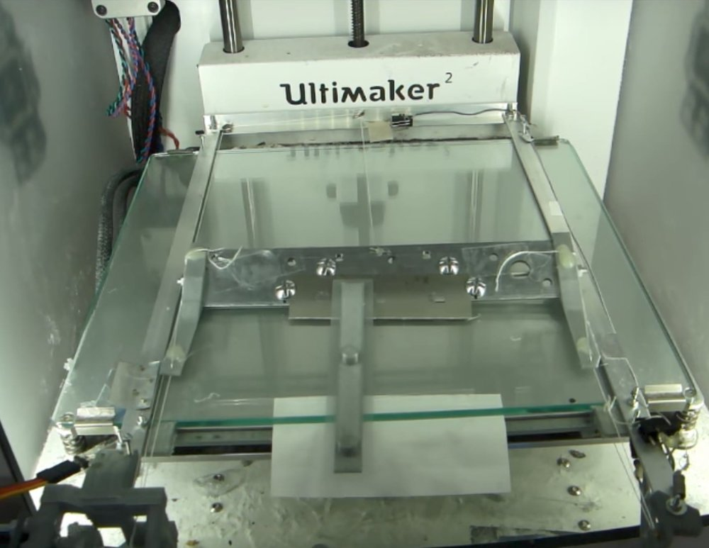 An automated print unloader installed on an Ultimaker 3D printer