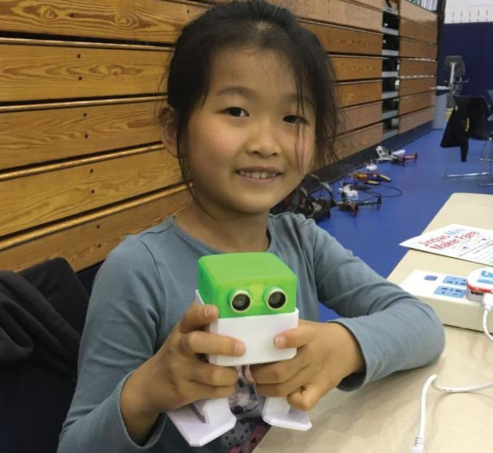 A student working with Otto, a DIY robot project