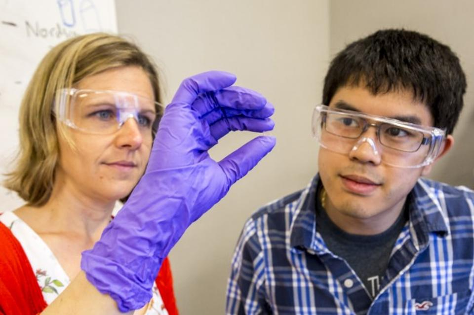 LLNL researchers checking out a 3D printed glass lens