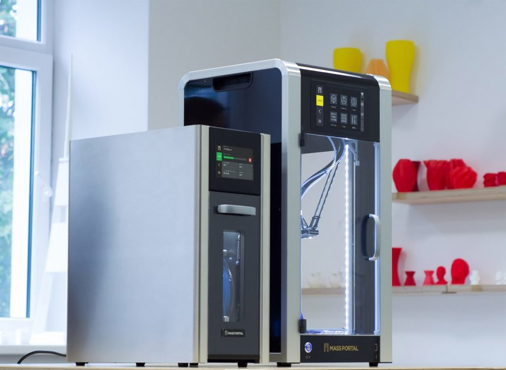 The new Mass Portal filament drying system feeding one of their delta 3D printers