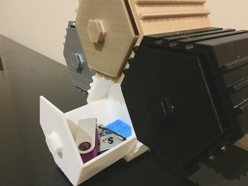 Reduce desktop clutter by putting your junk in the 3D printable HIVE stackable drawer system
