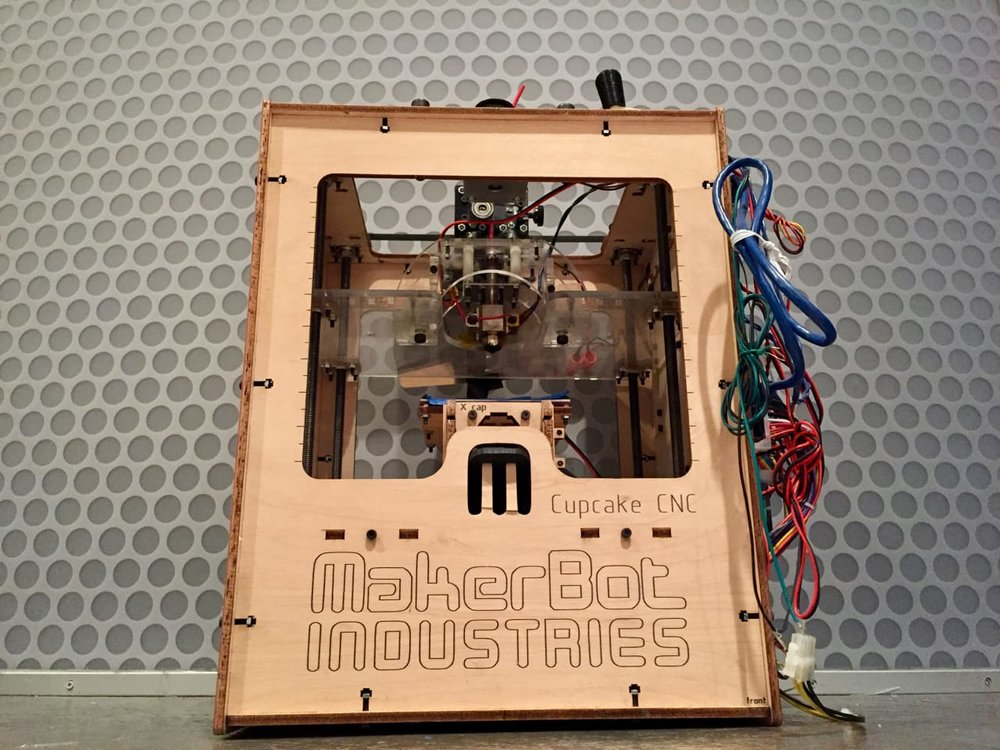 The original MakerBot CupCake desktop 3D printer, made from a kit of very small parts