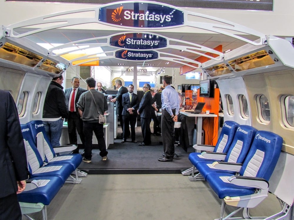 A Stratasys display at a 3D print trade show that looks suspiciously like an airliner