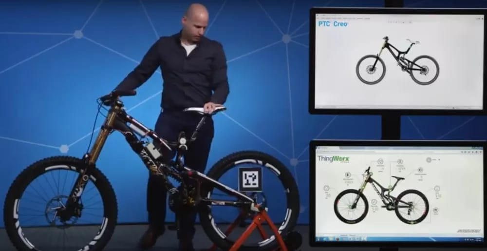 In what may represent the state of the art for digital twins in design engineering, a Santa Cruz road bike is shown at PTC's annual user meeting, ThingWorx 2017. Movement of the real bike is reflected in the digital twin, as well as its activity (speed, RPM, etc.). (Image courtesy of PTC on YouTube.)
