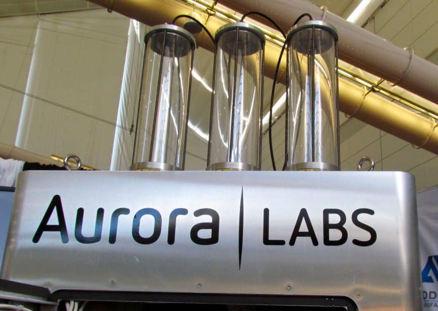 Three metal powder hoppers on top of the Aurora Labs 3D metal printer