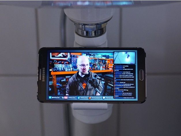 The 3D printed bathroom phone holder in use