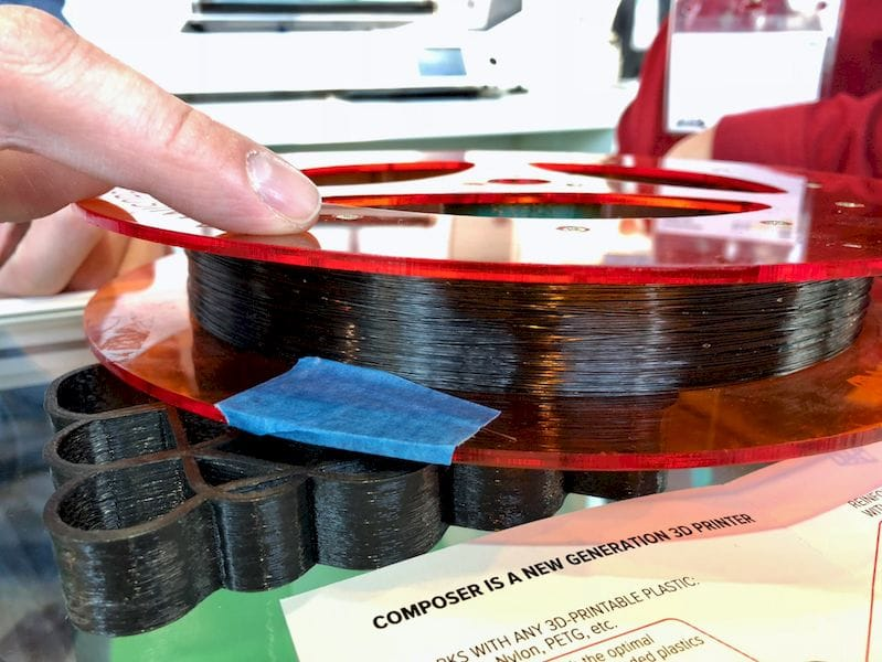 A spool of continuous carbon fiber, printable on the Anisoprint Composer