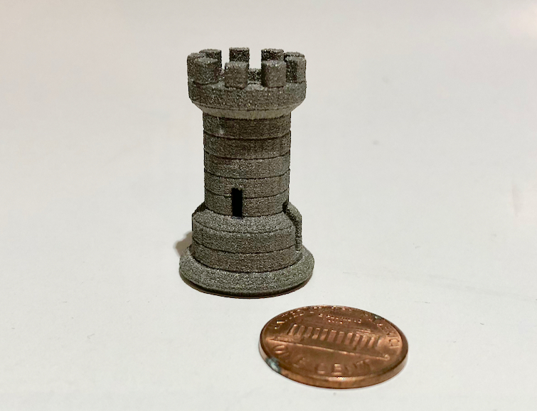 A sample 3D printed metal part made by Aurora Labs, showing considerable detail right out of the printer with no post processing.