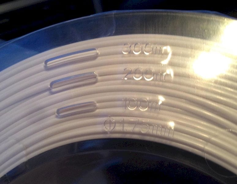 A spool that shows how much filament length remains