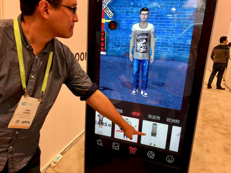 A virtual reality clothing simulation kiosk by ESUN Display