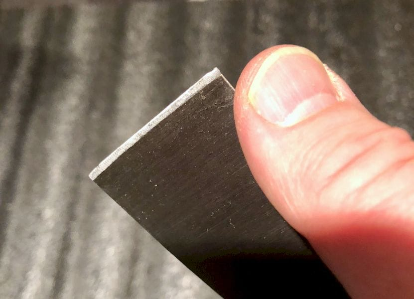 The razor-sharp scraper included with the Creality CR-10S desktop 3D printer. BE CAREFUL!