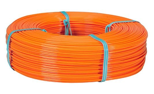 A coil of filament, sold at a lower price, could easily fit on a reusable spool