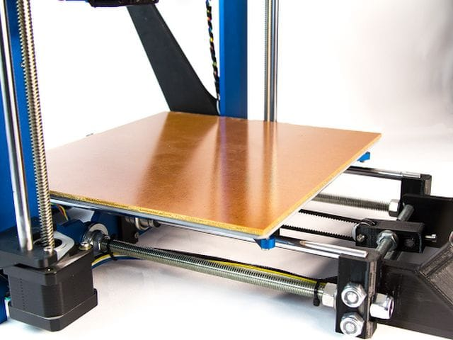 The garolite surfaced print bed on the Pulse XE desktop 3D printer