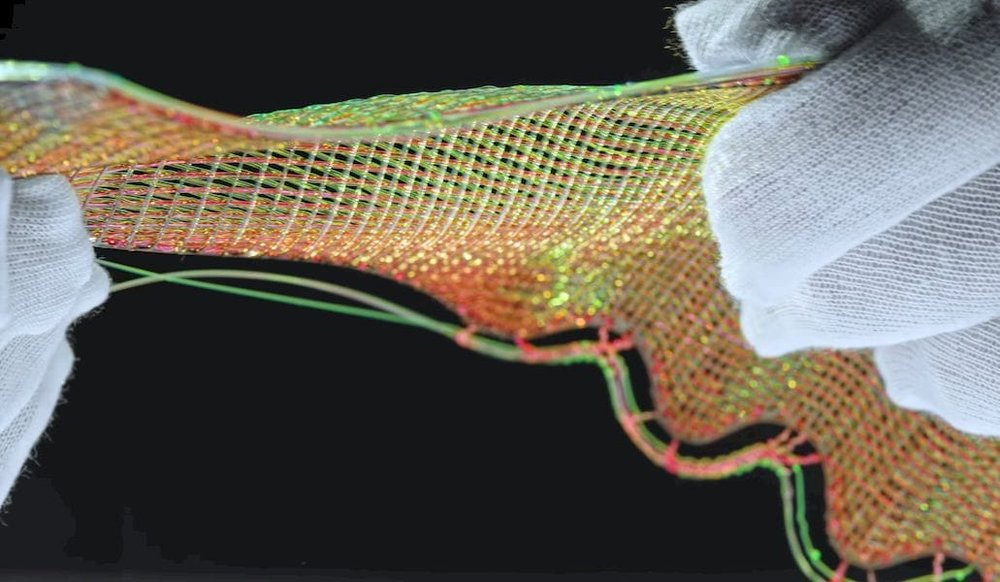 Testing the flexibility of Nike's Flyprint material