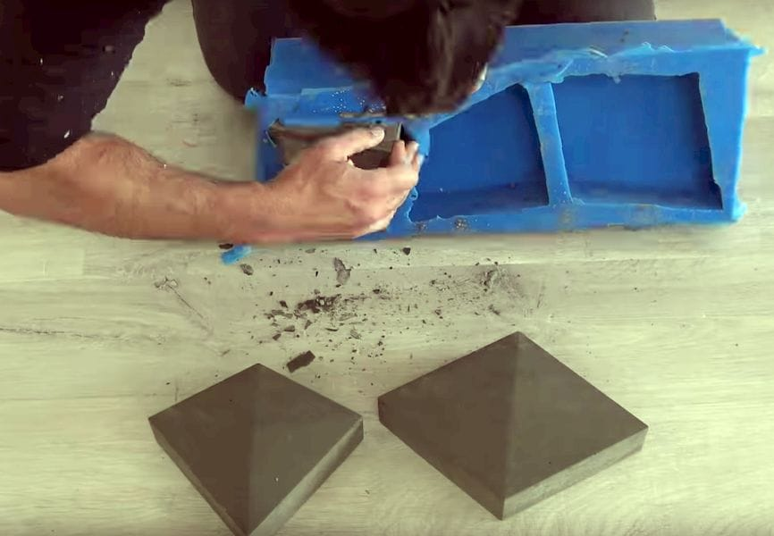 Extracting concrete bricks from the silicone mold