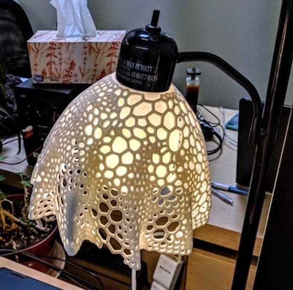 The Voronoi Flower Lampshade attached to an IKEA lamp