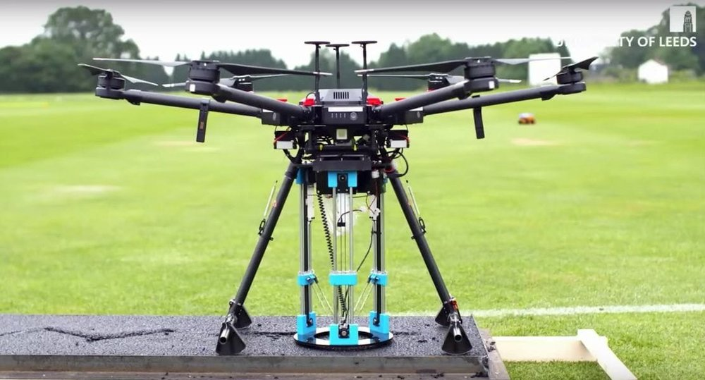 A delta 3D printer strapped to a drone to fill potholes???