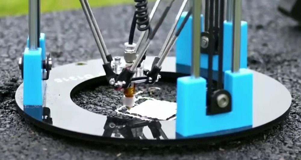 The pothole-filling drone-powered 3D printer is filling a pothole