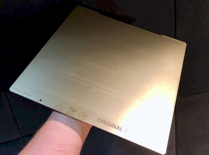 A typical flexible steel plate, coated with an adhesive layer specifically for 3D printing