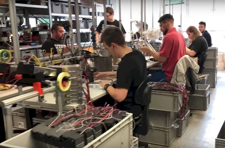 A small portion  of Prusa Research's team building 3D printers [Source: 3DMN]
