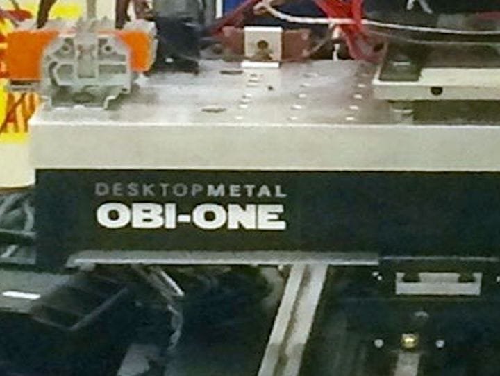Who made the Obi-One 3D metallic glass printer? [Source; ScienceDirect]