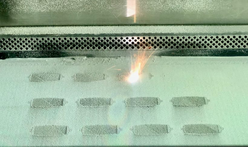 """Metal 3D printing in action: note the """"splash"""" of hot metal [Source: Fabbaloo]"""
