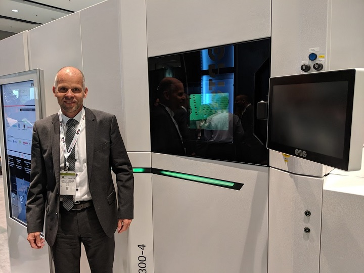 Dr. Adrian Keppler, CEO, EOS GmbH, with the new M300-4 at IMTS [Image: Fabbaloo]