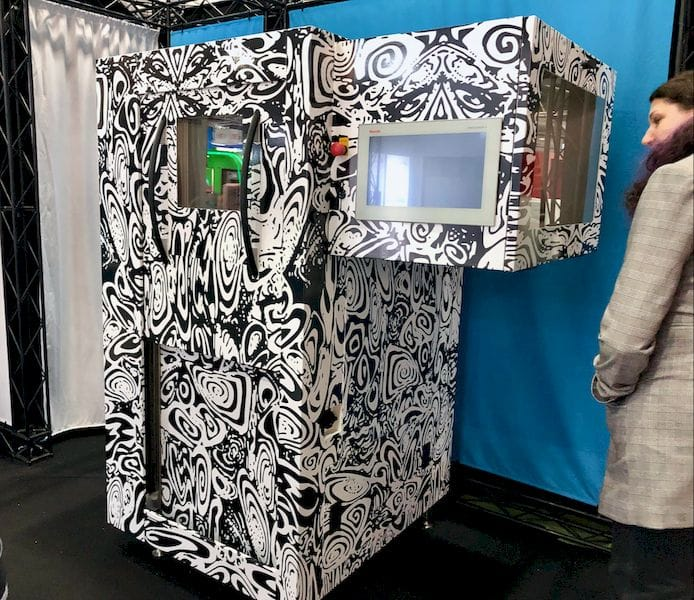 "Fabbaloo's Sarah Goehrke checks out the mysterious GEWO 3D ""zebra"" prototype [Source: Fabbaloo]"