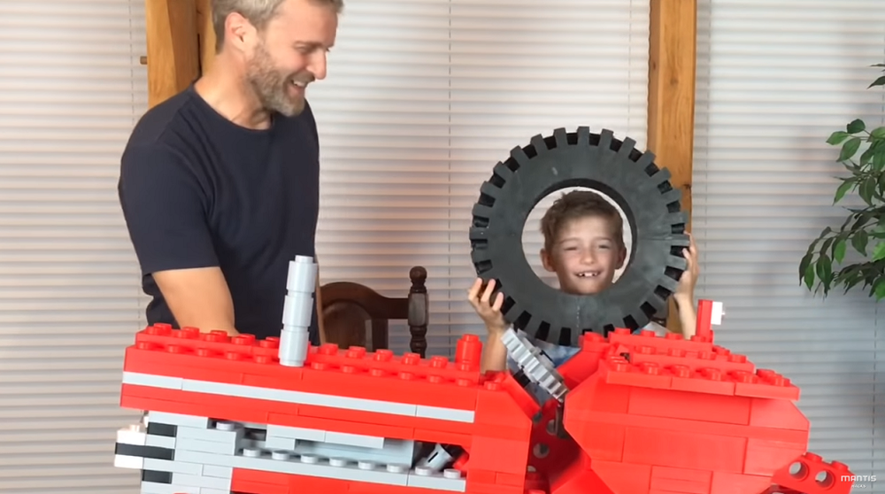 Child's head for scale [Image via YouTube]