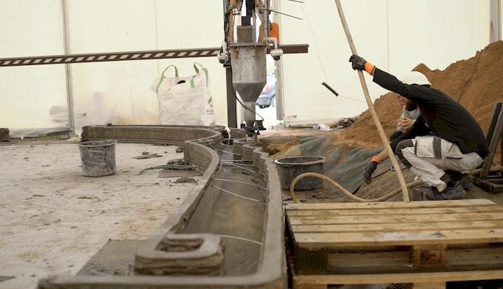 A typical concrete-extrusion construction 3D printer in operation [Source: Cobod]