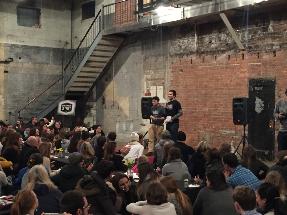 Andrew Darmahkasih and John-Michael Guest presenting on behalf of Street Medicine Detroit at the January Detroit SOUP.