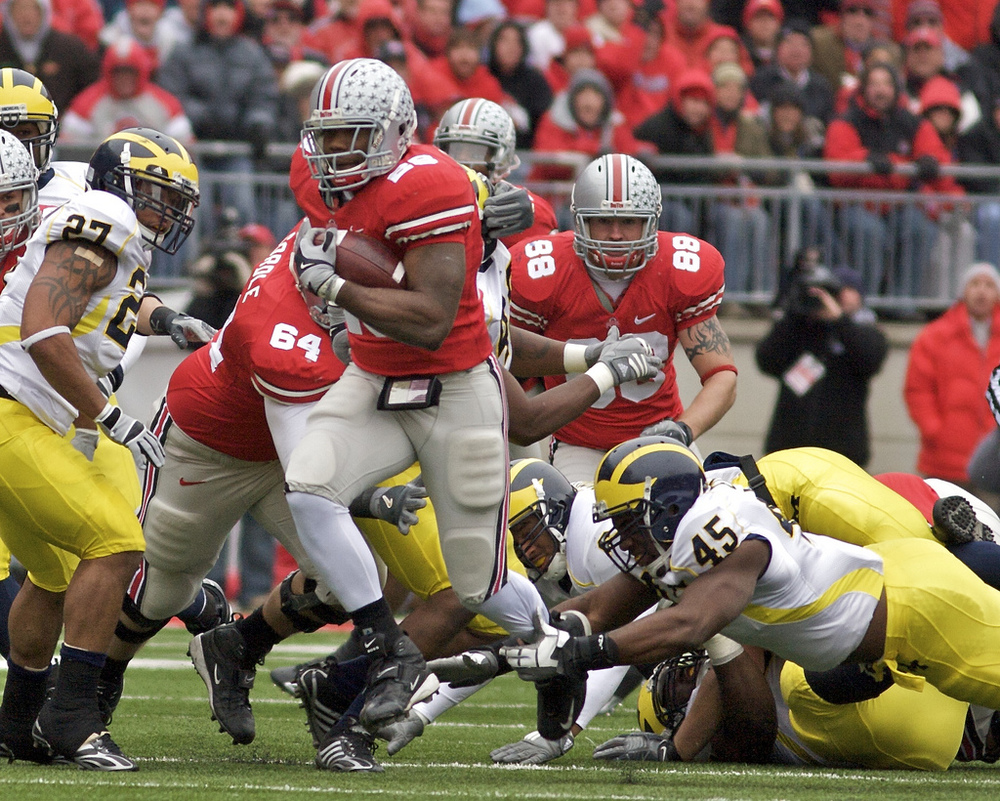 Beanie Wells escapes the grasp of Michigan linebacker Obi Ezeh to score on a 59 yard run. Photo courtesy @photogoofer