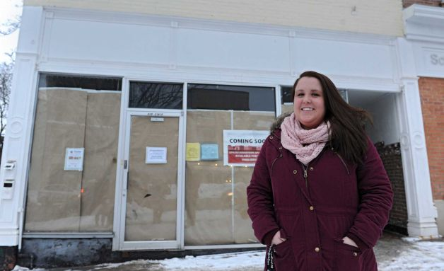 Sara Mae Hickey, founder and president of The Autism Initiative, stands in front of the construction site for Puzzles Bakery & Cafe on State St. on Wednesday, Feb. 19, 2014, in Schenectady, N.Y. The cafe, which will open in the Spring, will be a place for adults with autism to work. Sara Mae's sister is on the autism spectrum.