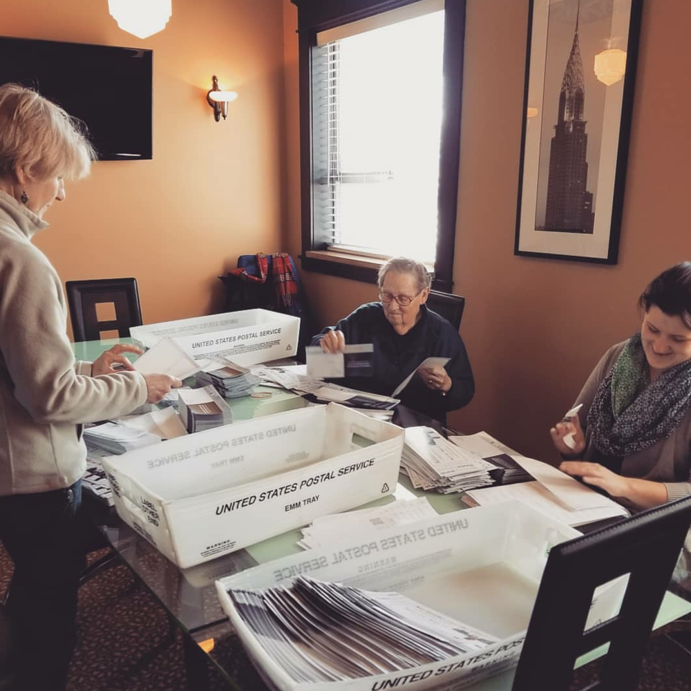 Volunteers help with our office mailing (2018).