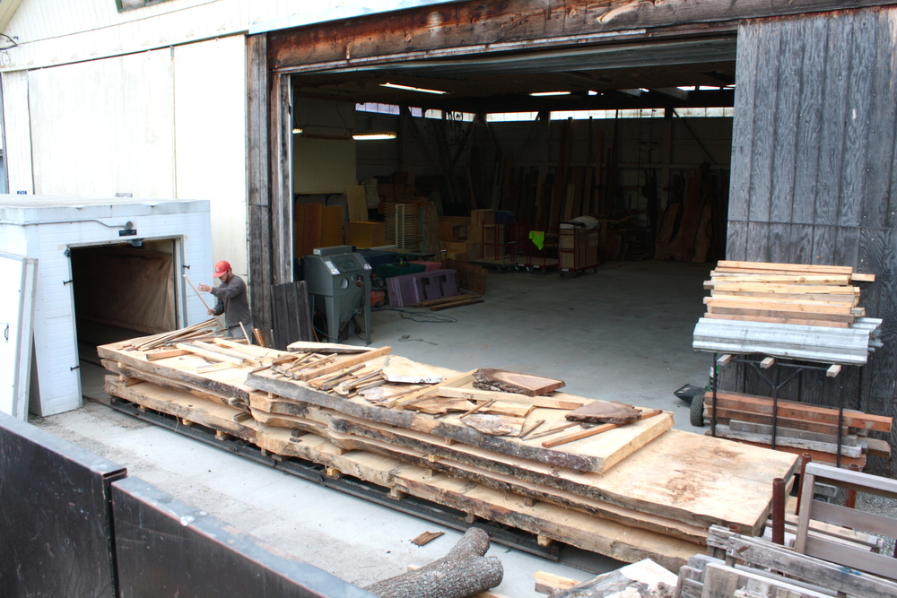 Cody begins unpacking wood from the kiln, which has been drying for 3 months at a temperature of 200 degrees.
