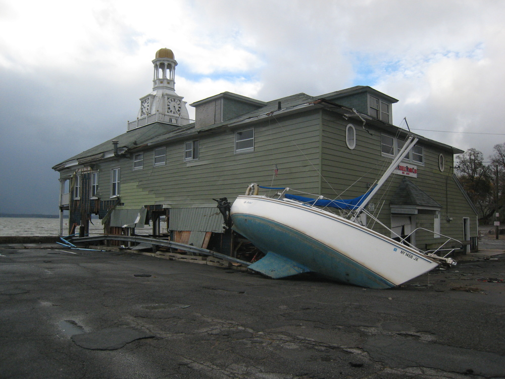 Hurricane Sandy - two boats batter the boathouse but the structure remains strong