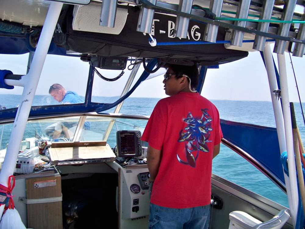 Captain scouting, Rudy on the bow ready to drop anchor