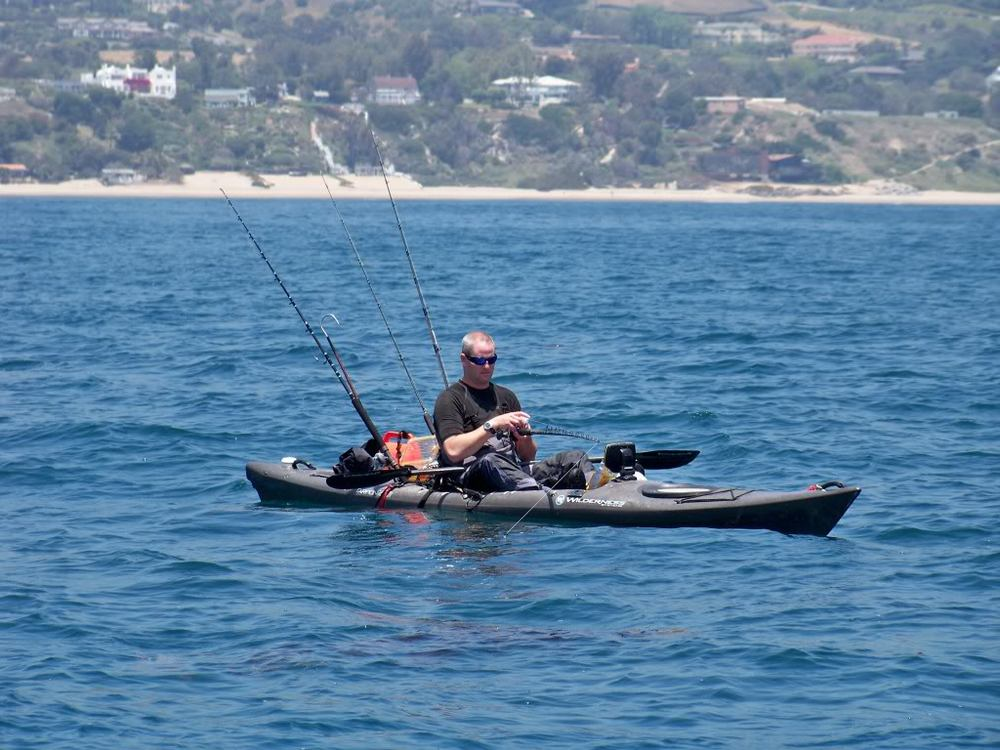 Equipped kayaker reading his sonar