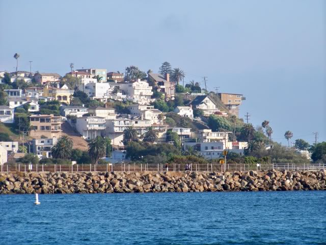Playa Del Rey in the background over the jetty separating the marina inlet from Ballona Creek, Playa Del Rey is a community of Los Angeles, the name translates to Beach of the King