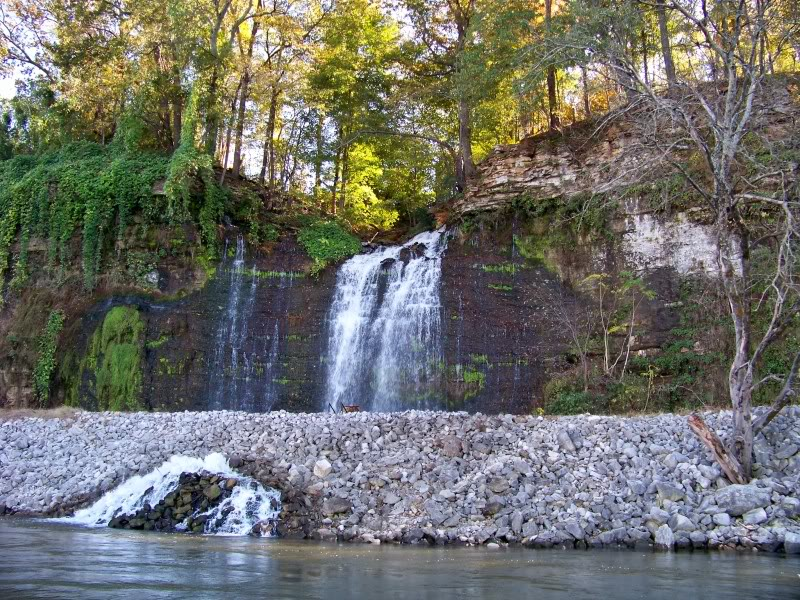 A waterfall above the rip rap.