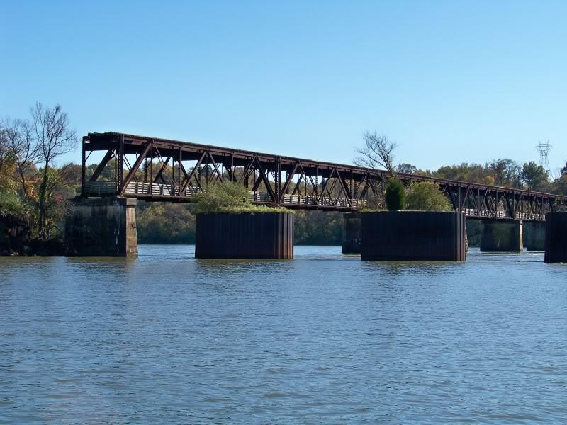 Moorings in front of an old railroad bridge. A section of the railroad bridge has been removed after the creation of Pickwick Lake to accommodate barge traffic. The bridge has been converted to a scenic pedestrian walkway.