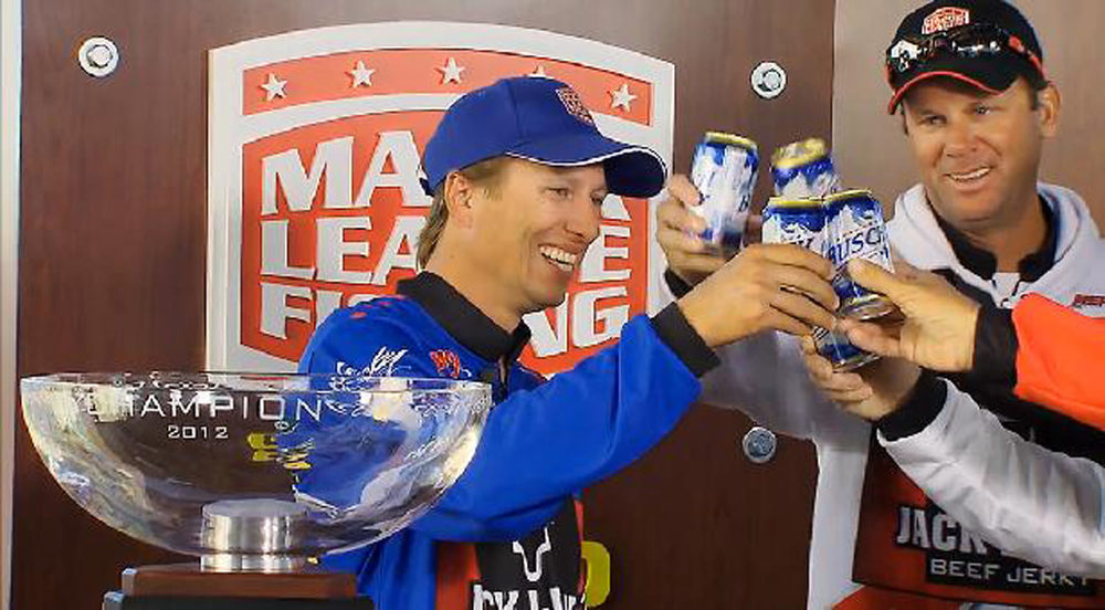 Major League Fishing Lake Amistad 2012 Challenge Cup Champion Ehler receives a toast from his Bassmaster Elite peers, photo by MLF