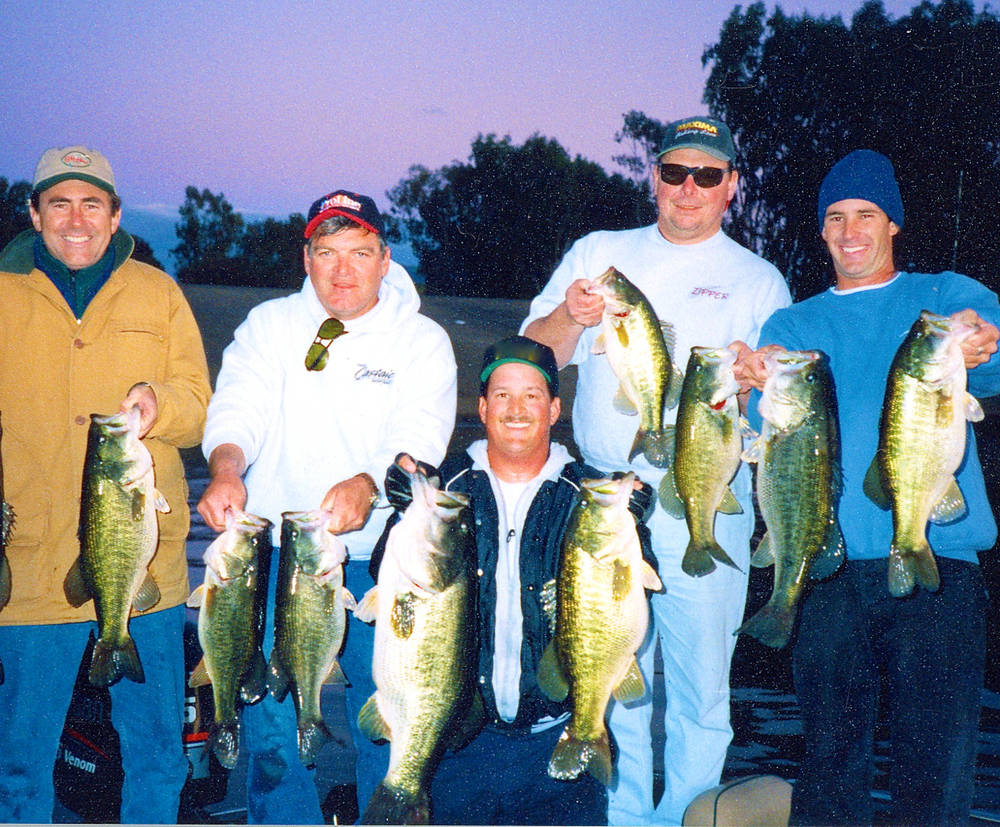 Bill Siemantel's 10 fish limit with helping hands. Can you name the guys. Note the man on the far left was Bill from OutDoor Mag. Go.