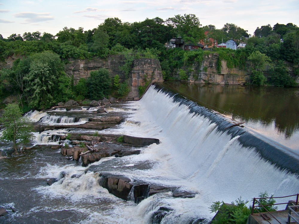 Near Woodstock just before joining the Hudson River in the town of Saugerties is Esopus Creek and its dam waterfall.