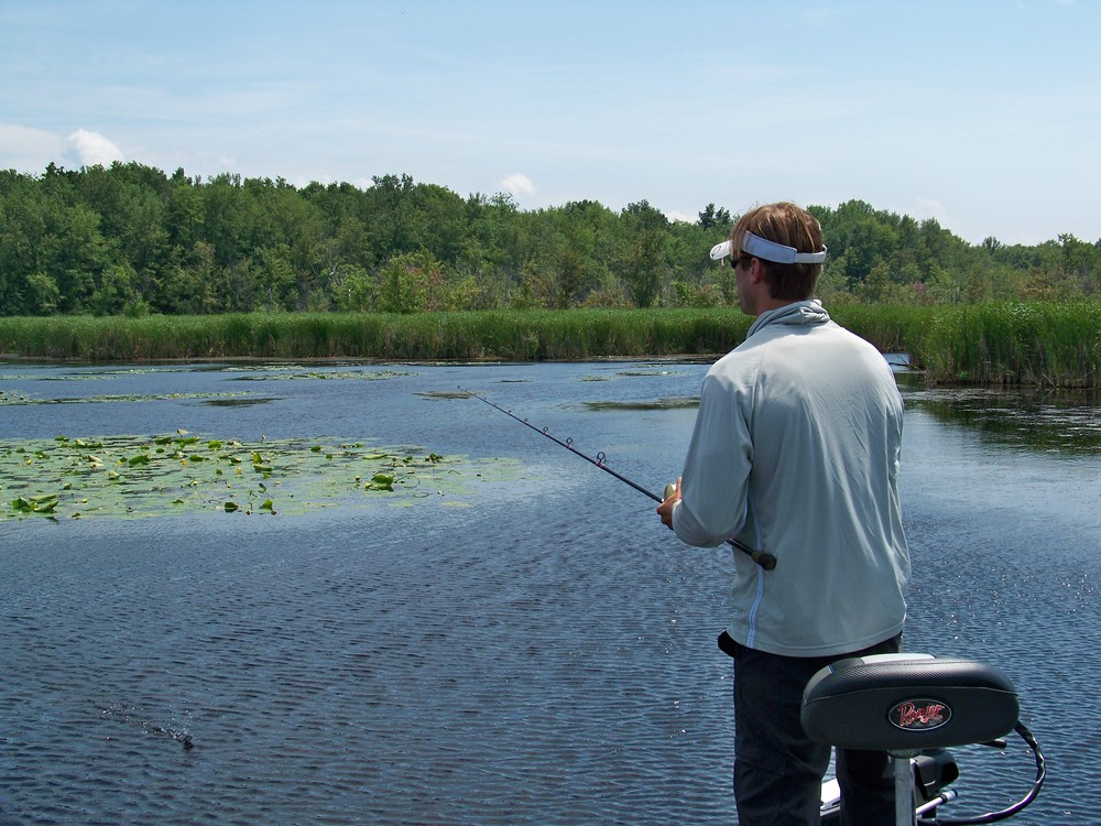 Exposure to diverse fishing venues is why I love to travel. Troy is fishing water lily pads in Missisquoi Bay just south of the U.S. Canadian border.