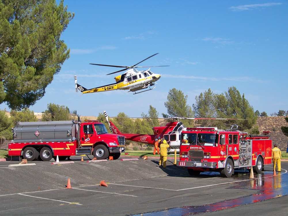 Fire station crews pumping water to helicopters from the Castaic lagoon.