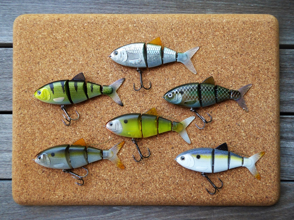 "SPRO BBZ-1 4"" Shad line-up. Top Center – Blue Back Herring, Middle Left – Wicked Perch, Middle Right – Killer Gill, Middle Center – Dirty Shad, Bottom Left Natural Shad, Bottom Right – Sexy Lavender Shad"