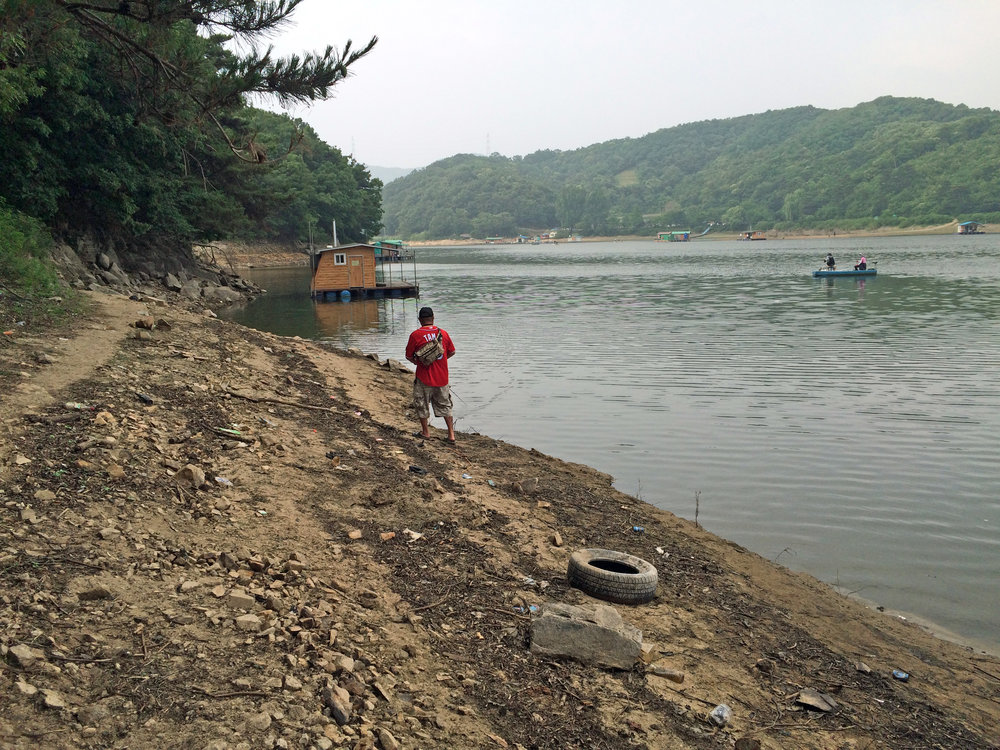 Pic. 1. Shore bass fishing at a shrunken Gosam Reservoir during the rice farming season in South Korea