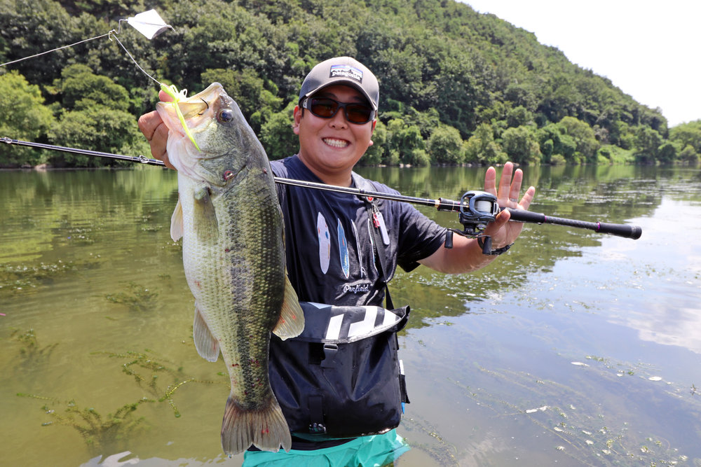 Pic. 11.  My local fixer, Kang caught this big bass on a buzzbait in the midday heat.
