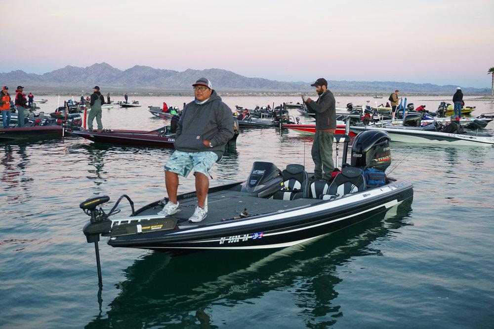 California Pro Bass Angler Mike Phua, on the front deck, waits for a Havasu tournament take-off.